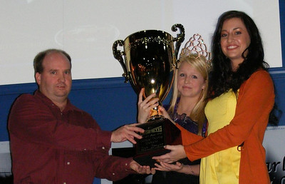 Dan Breuer of Troutman, NC receives the NeSmith Cup from Trophy Presenters Katie Williamson and Amber Lee for winning the 2011 NeSmith Chevrolet Dirt Late Model Series Touring Championship during the series Awards Banquet on Saturday night at the Georgia Racing Hall of Fame and Thunder Road USA Museum in Dawsonville, GA.  (Angela Williamson Photo)