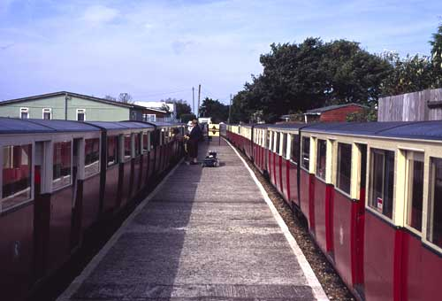 Two trains are usually standing at Romney Sands station. The line is single track from here to Dungeness, and the driver of the up train hands the single line working token to the driver of the down train. The train on the left is working the 12.18 to Hythe.