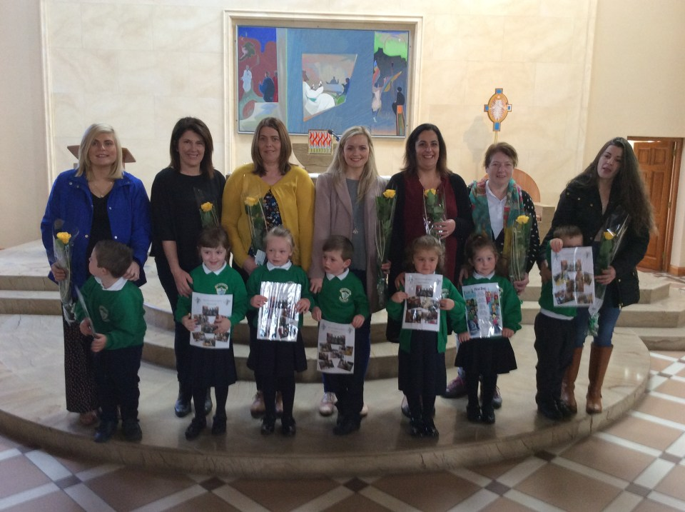 Our new P1 pupils present family members with a yellow rose