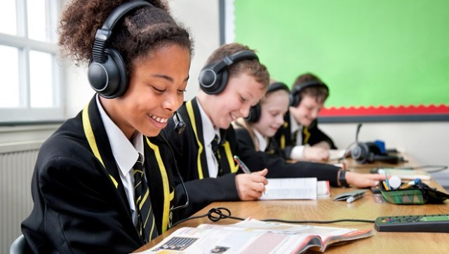 Pupils listening to headsets