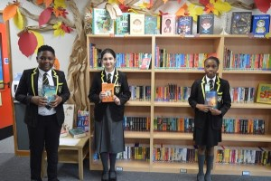 Children from Years Five and Six make selections from their new book area