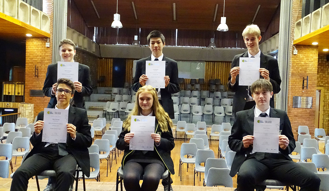 Students collect their Silver Chemistry Crest Award certificates