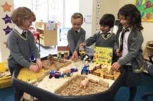 Reception pupils play in the sand pit