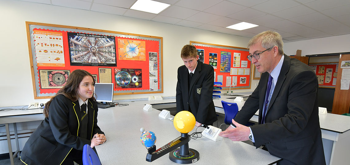 Sixth Form students in a Physics lesson with Dr Owen