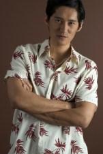 A well-built asian model in a casual shirt