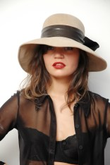 Pretty Model in Black Shirt with Hat