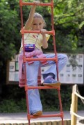Young Girl on Robe Ladder