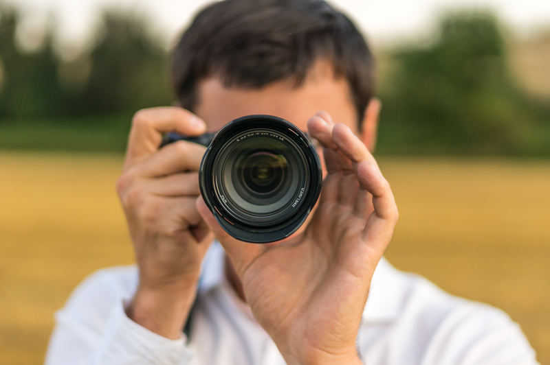 Man Aiming Camera