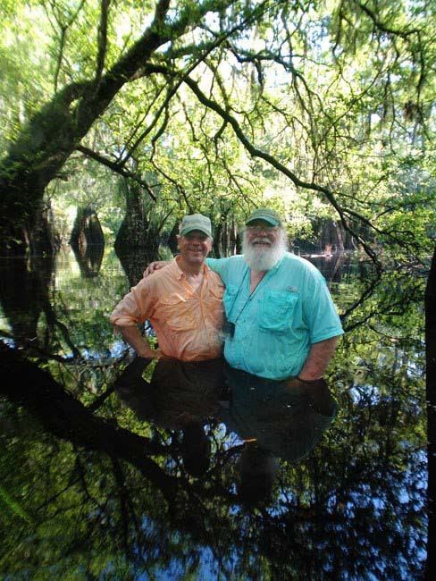 Clyde and Elam in 2013 standing in the Suwannee River.