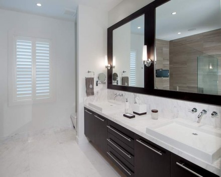 The bamboo-marble is a sharp contrast to the design on the opposite side of the bathroom.