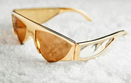 The frame of the sunglasses are made of gilt metal with Paonazzetto marble inlay.