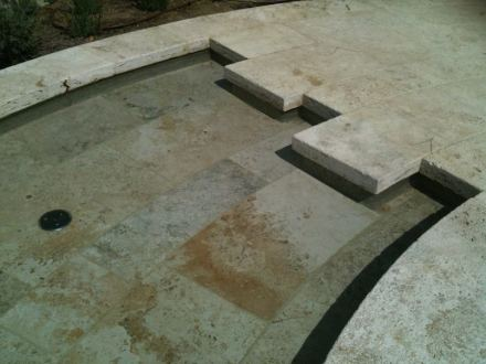 The stone installed inside the pool for the paving and steps was treated with a special patina finish and subsequently stuccoed.