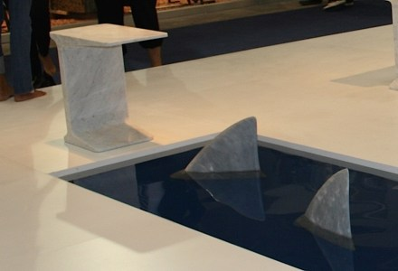 Shark fins of marble as stoorstoppers.