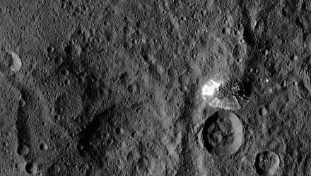 Ceres: The conical mountain's perimeter is sharply defined, with almost no accumulated debris at the base of the brightly streaked slope.