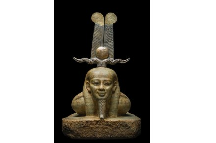 """The reawakening of Osiris, Egyptian Museum, Cairo. The warmly colored gneiss sculpture from the 26th dynasty shows the rising god returning to life. His face of timeless beauty expresses serenity and the full certitude of youth renewed. He bears the crown called """"tcheni"""" (the word meaning """"to lift"""", to """"raise""""), a headdress often associated with the rising sun, made of gold, electrum and bronze."""