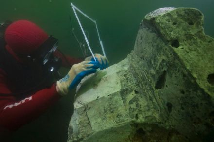 Base of a column, Thonis-Heracleion, Aboukir Bay, Egypt An archaeologist measures in situ the foot of a column discovered at the site of the temple of Amun-Gereb of Thonis-Heracleion.