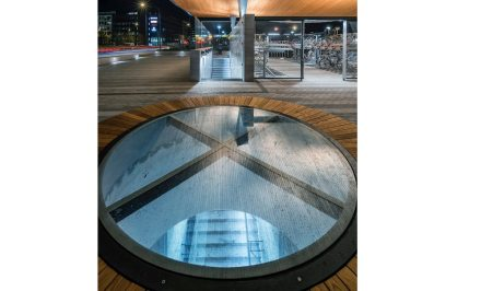 The round benches mounted around a type of looking hatch are an eye-catcher and allow daylight to flood the lower level.