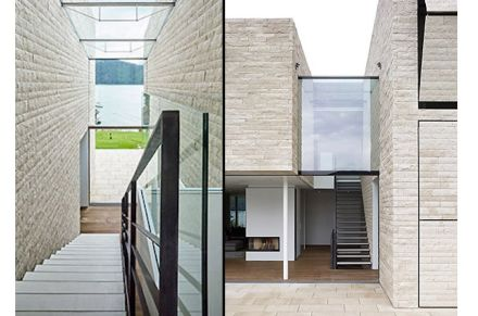 A kind of canyon in the middle of the house accommodates the stairwell and is also clad in stone.
