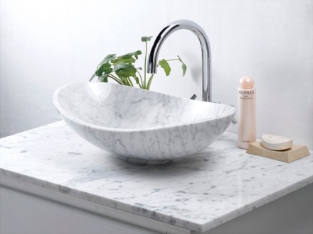 Since some years, Chinese companies like Jinjiang Huabao Stone are producing bathroom furniture for reasonable prices. Their design is down-to-earth, distribution is through building centers.