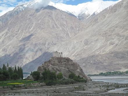 The picture of a temple in the Nubra Valley of Ladakh, India illustrates the enormous size and scale of the mountains in this part of the Himalayas. Photo by Wendy Bohon