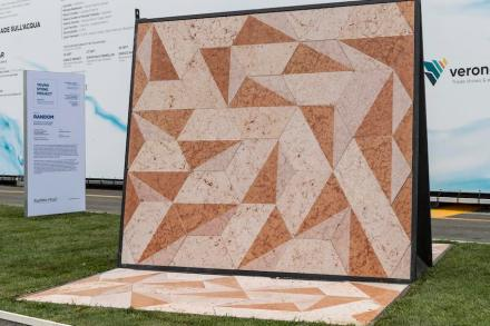 RANDOM. Randomize your wall design: The project was conceived as a wall cover made of regular hexagonal slabs. The material used is marble of Verona. The material is very easy to work with, allowing for a wide range of colors and finishing touches. The hexagonal plate is divided into two symmetrical parts, a part that retains the rough finish of the material, and the second part that has two very distinguishing finishing touches: glossy and satin. The unique concept of RANDOM slabs only gets value and appeal when, as a result of rolling differently each plate, an exclusive model is reached. It was made at the Scuola del Marmo of Sant'Ambrogio and the students of the Scuola Edile took care of the assembly.
