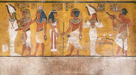 "The north wall of the burial chamber depicts three separate scenes, ordered from right to left. In the first, Ay, Tutankhamen's successor, performs the ""opening of the mouth"" ceremony on Tutankhamen, who is depicted as Osiris, lord of the underworld. In the middle scene, Tutankhamen, dressed in the costume of the living king, is welcomed into the realm of the gods by the goddess Nut. On the left, Tutankhamen, followed by his ka (spirit twin), is embraced by Osiris. Source: Carleton Immersive Media Studio; Carleton University © J. Paul Getty Trust"