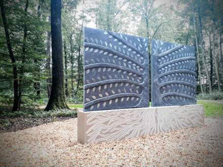 """The """"Tree of Rest"""" by Elsa Sculpteur at a forest cemetery in Luxembourg."""