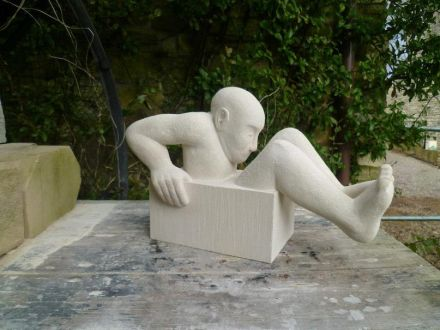 """Peter Crinnion: """"Bloke (With His Arse Stuck) in a Box"""", 2012, Portland stone, 250mm high."""