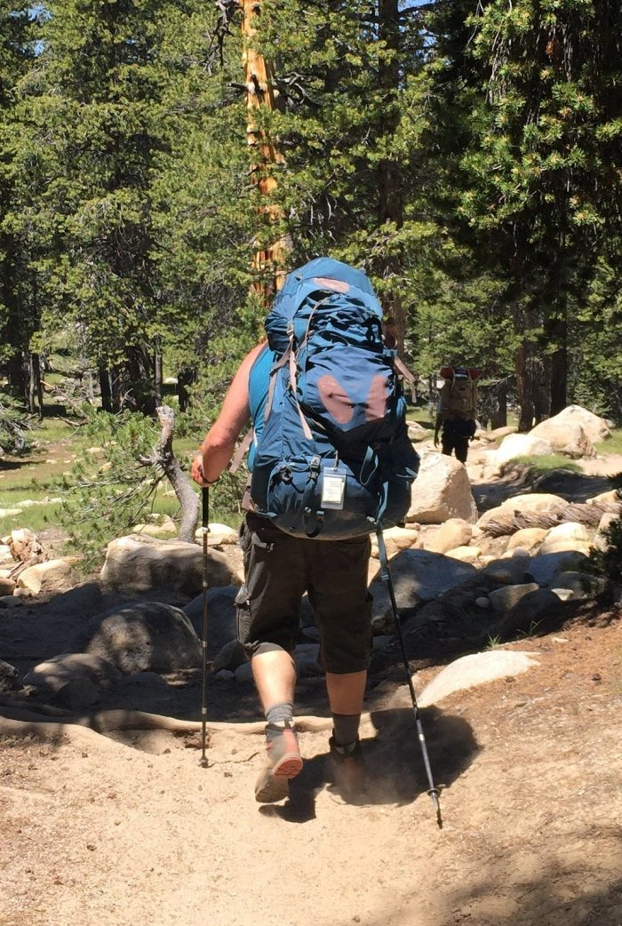 A weekend hiker on the PCT with a giant backpack towering over their head