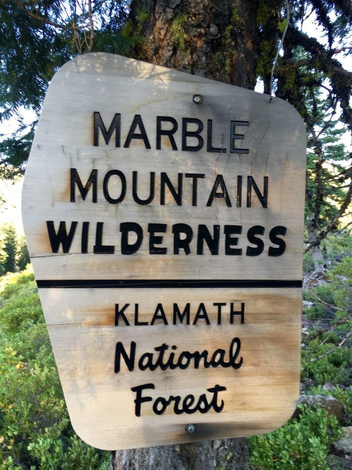 Sign marking boundary of Marble Mountain Wilderness Area