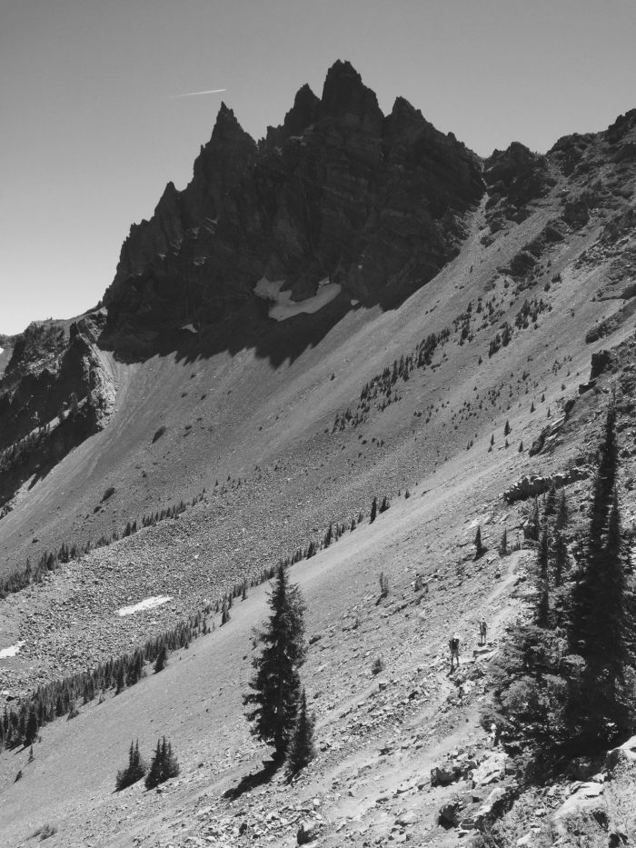 Talus slopes sweeping up to steep north face of Three Fingered Jack