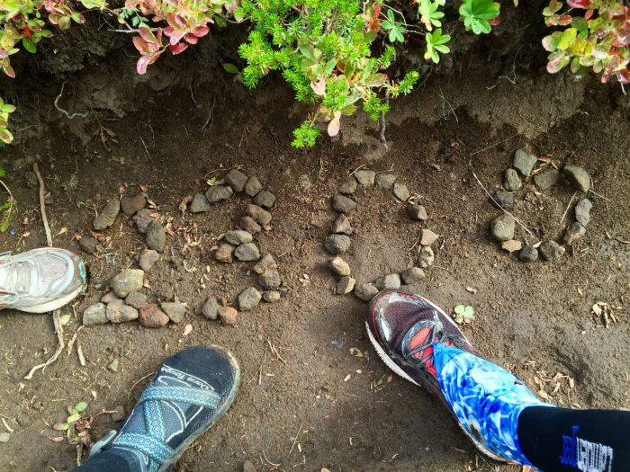 Feet next to the PCT 2300 mile marker