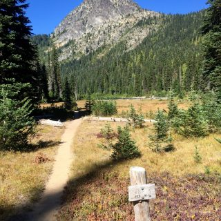 Trail sign under blue skies near Deep Lake and Cathedral Rock