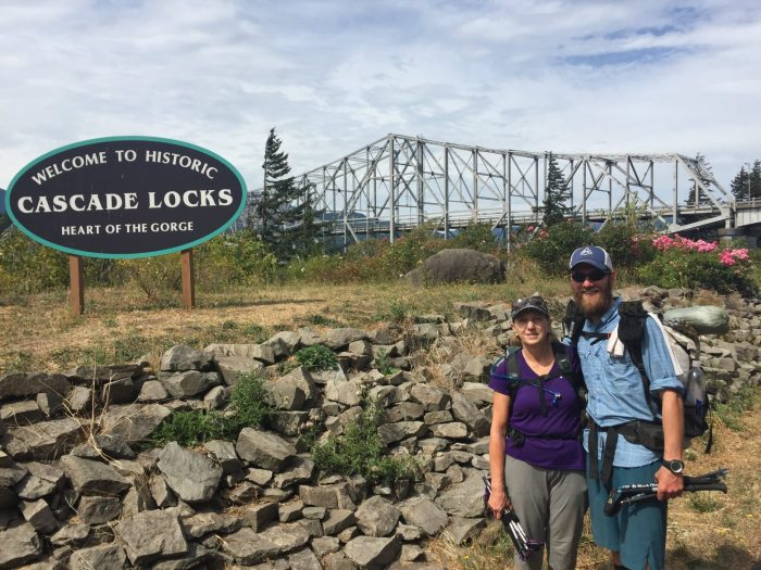 Mountain Mom and Mountain Man in front of Cascade Locks sign