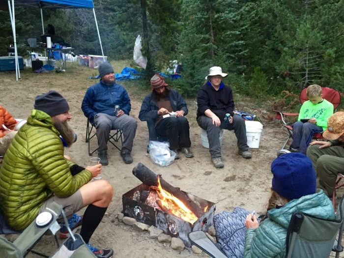 PCT thru-hikers gathering around a fire at trail magic
