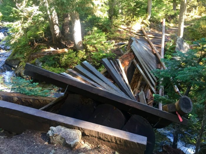 Trail bridge over a creek completely destroyed and unusable