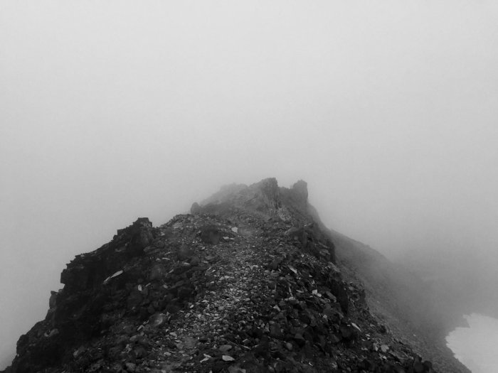 Rocky trail through the clouds on the Knifes Edge