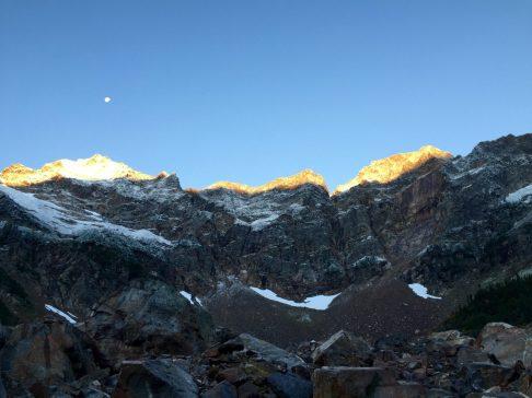 First rays of sun on jagged peaks near Stehekin