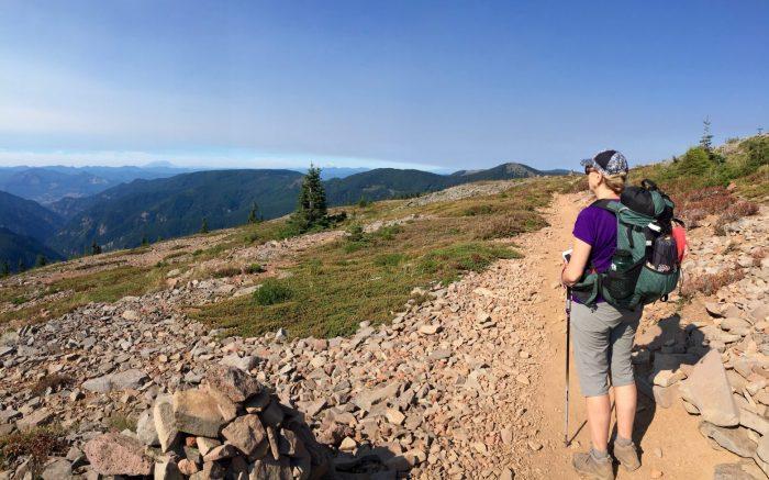 Mountain Mom on an exposed ridge gazing into Washington