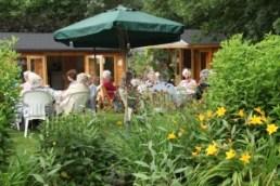 Group enjoying outdoor refreshments outside the tea room