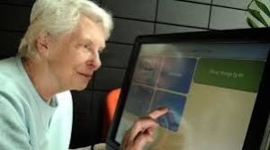 elderly woman with touch screen