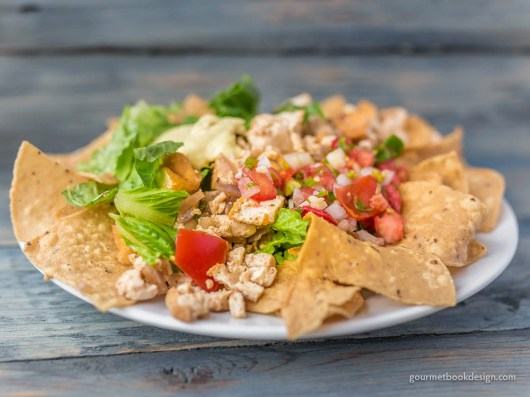 Taco salad: Fried tofu, red onions, chipotle salsa & avocado, over a bed of Romaine & local corn chips
