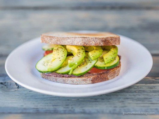 Black bean hummus sandwich w/cucumber, avocado, & tomato on BosqueBaking sourdough