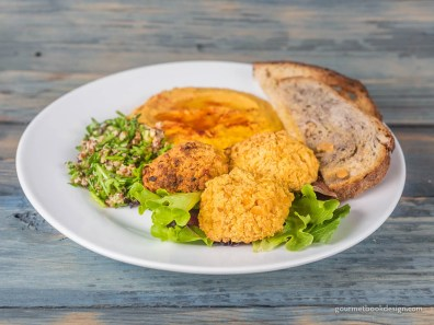 Chickpea fritters, pepper hummus, tabouli, and crostini