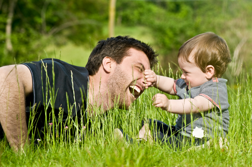 cute little child joke outdoor with dad