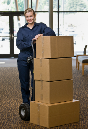 Young Woman Moving Boxes