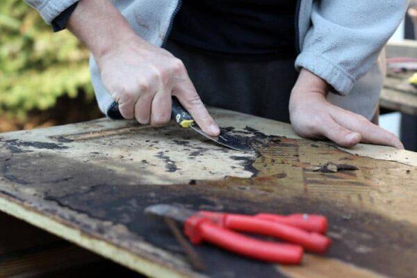 a man restoring old furniture