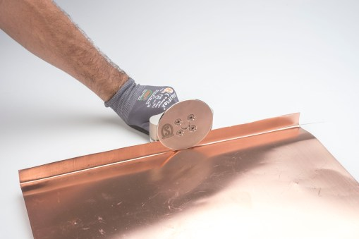 Copper hemming tool