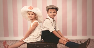 Girl and boy in old-fashioned clothing
