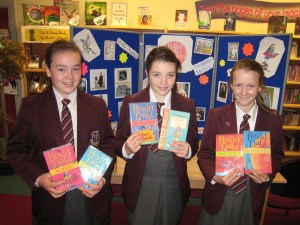 Claire Ward 9/27, Meabh O'Brien 9/43 and Lisa Devlin 9/27 celebrate Roald Dahl Day in the Library.
